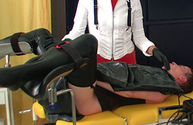 Milking up the slave on the gynchair