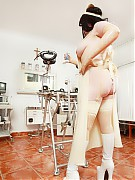 Bound at gynochair in rubber clinic