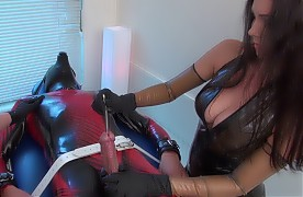 Gorgeous Mistress Susi and Lady Luciana have plans for your cock tonight. Strapped to the examination bench in your rubber outfit, with mask, they make your cock rock hard solid, then decide to plug your hole with different sizes of sounds. After some nice orgasm control, they make you cum.