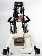 Teenage girl bounded and humiliated at gyno chair in rubber clinic by kinky nurse in latex