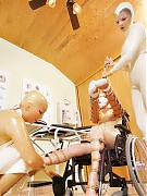 Kinky nurses in latex put into wheelchair immobilized patient