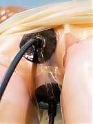 Transparent latex dressed doctor and patient kinky games in rubber clinic