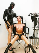 Rubber clinic patient, dressed in latex, was bound to a wheelchair and play gasmask game
