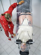 Latex clinic medical table bounded, and gagged patient flipped upside down