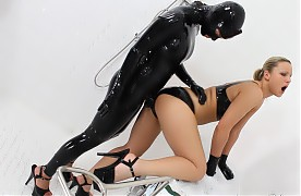 Rubber doctor Victoria, who wears black rubber catsuit, black latex gloves and high heels fetches some rubber garments to proceed with the next step. Rubber patient Samantha, in a black rubber bra, rubber hot pants with open crotch, latex gloves and high heels, assists Victoria to don a rubber mask, a rubber cap and a pair of rubber strap-on pants. After that Samantha sucks the rubber cock of Victoria's strap-on pants. Then Victoria lubricates Samantha's cunt before she treats Samantha's pussy w...