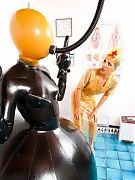 Rubber clinic patient waiting for the doctor dildo fuck