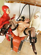 Two kinky nurses in latex prepare their patient for gyno and ass examinations