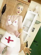 Patient in white rubberdress was fastened to the examination chair and examined