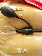 Rubber clinic patient was placed in the vacuum mattress of nurse Inanna and fitted with a breathing mask and plug