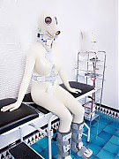 Nurse is going to adjust a pair of orthoses to rubber clinic patient