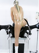Medical fetish session with gasmasks in rubber on the gyntable