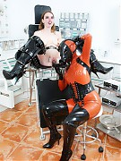 Rubber clinic patient getting mouth spreader and speculum