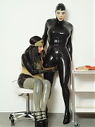 Rubber patient forced to control breath while rubber nurse is playing with her