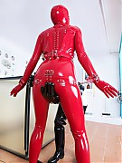 Rubber clinic patient all in red latex in vacuum cube