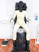 The rubber-psychiatry patient tied to the special chair and is placed inflatable mesh mask