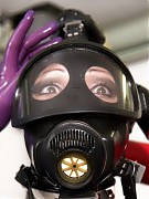 Rubber clinic patient was tied to a gyn chair where she breathing oxygen through gas mask